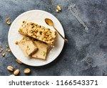 homemade organic sesame halva.... | Shutterstock . vector #1166543371