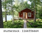Finnish wooden lakeside cabin  exterior in wooded setting with path