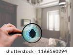 hand with magnifying glass... | Shutterstock . vector #1166560294