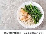 fish fillet served with rice ... | Shutterstock . vector #1166561494