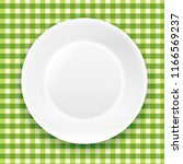 green checkered cloth and white ... | Shutterstock . vector #1166569237
