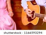 golden blues. man's male hands... | Shutterstock . vector #1166593294