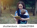 happy mom with a baby in a... | Shutterstock . vector #1166629384