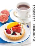 Delicious cake with custard cream and fresh fruits. - stock photo