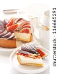 Delicious cheesecake with fresh figs on a white. - stock photo