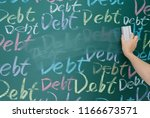 wiping debt on a chalkboard. | Shutterstock . vector #1166673571