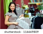 pretty elegant woman in clothing store - stock photo