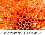orange pvc pipes stacked in... | Shutterstock . vector #1166703937