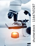 close up of microscope at... | Shutterstock . vector #1166765287