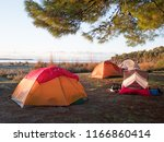 camping with tents near the sea | Shutterstock . vector #1166860414