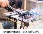 the blacksmith forge.... | Shutterstock . vector #1166892391