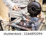 the blacksmith forge.... | Shutterstock . vector #1166892394