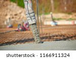 concrete pouring during... | Shutterstock . vector #1166911324