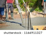 concrete pouring during... | Shutterstock . vector #1166911327