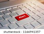 alert word on red keyboard... | Shutterstock . vector #1166941357