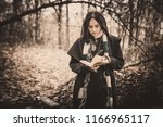charming lady with dreadlocks... | Shutterstock . vector #1166965117