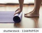 close up on feet and hands of... | Shutterstock . vector #1166969524