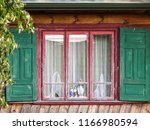 old wooden village house with... | Shutterstock . vector #1166980594