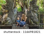 mom and son travelers... | Shutterstock . vector #1166981821