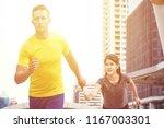 white male jogger giving water...   Shutterstock . vector #1167003301