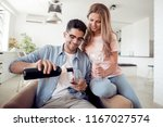 loving young couple with wine... | Shutterstock . vector #1167027574