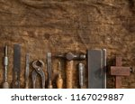 old woodwork tools on grungy...   Shutterstock . vector #1167029887