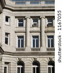 This is a close-up example of neoclassical style architecture. - stock photo