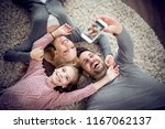top view of happy family are... | Shutterstock . vector #1167062137