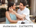 smiling young couple embracing... | Shutterstock . vector #1167065791