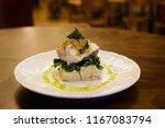 gourmet baked codfish set on a... | Shutterstock . vector #1167083794