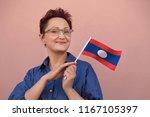 laos flag. woman holding laos... | Shutterstock . vector #1167105397
