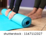 young woman with yoga mat... | Shutterstock . vector #1167112327