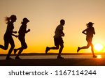 group of young people runs at... | Shutterstock . vector #1167114244