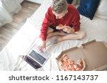 young man in a red sweatshirt... | Shutterstock . vector #1167143737