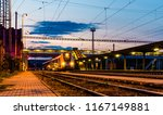 evening at train station and... | Shutterstock . vector #1167149881