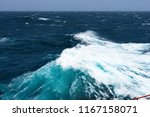big waves at open sea. summer... | Shutterstock . vector #1167158071