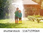 happy children under summer... | Shutterstock . vector #1167159064