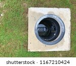 a hole of grease trap with the... | Shutterstock . vector #1167210424