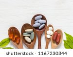 variety of vitamin pills in... | Shutterstock . vector #1167230344