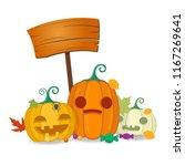 halloween pumpkins with wooden... | Shutterstock .eps vector #1167269641