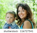 happy mother with boy   against ... | Shutterstock . vector #116727541