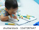 2 years old asian toddler boy... | Shutterstock . vector #1167287647