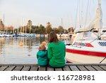 Family Sitting On Pier