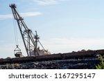 a huge excavator carries rock... | Shutterstock . vector #1167295147