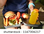 schoolboy eating outdoors the... | Shutterstock . vector #1167306217