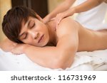 relaxed guy receiving spa... | Shutterstock . vector #116731969
