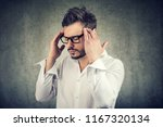 adult man in glasses holding... | Shutterstock . vector #1167320134