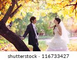 couple with bubble blowers in... | Shutterstock . vector #116733427