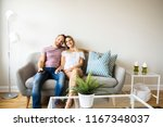 couple watching tv at home... | Shutterstock . vector #1167348037