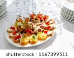 solemn banquet. lot of glasses... | Shutterstock . vector #1167399511